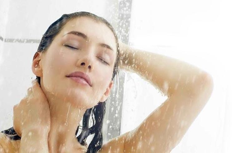 Wash your tresses with cold water to prevent hair loss